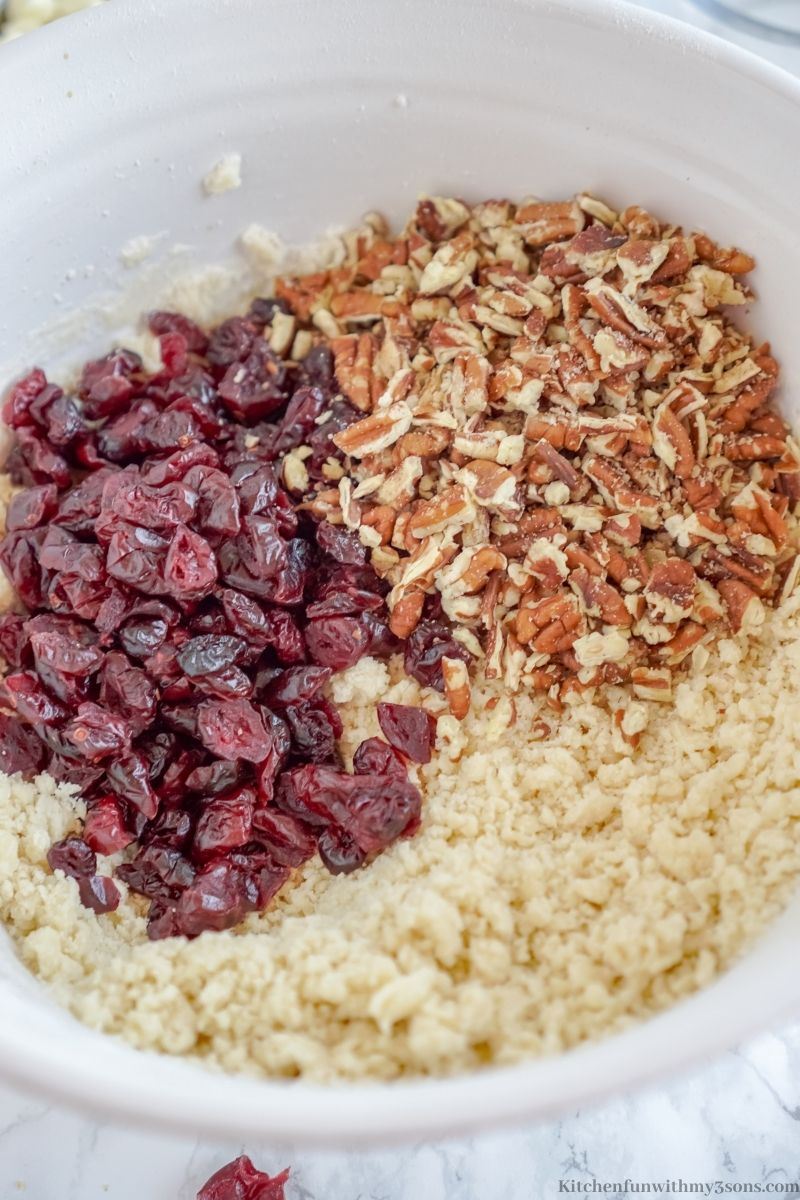 Adding in the pecans and cranberries.