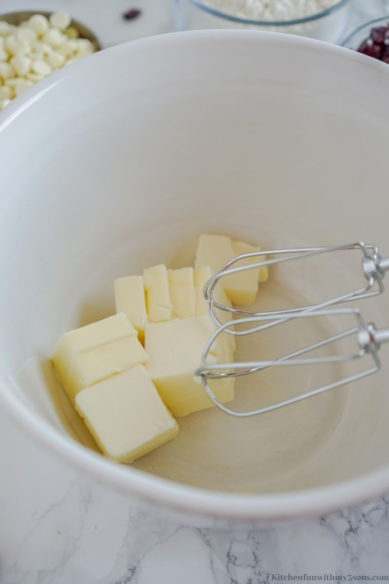 Adding the butter into the bowl to start the batter.