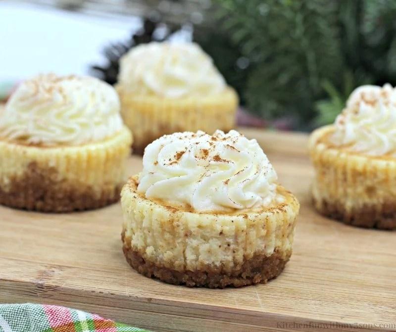 Eggnog Mini Cheesecake arranged on a board.