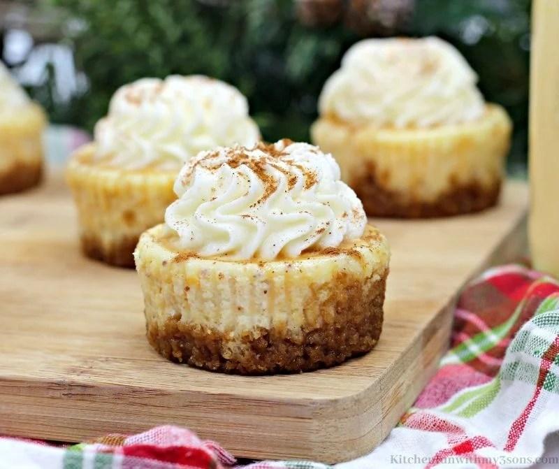 Eggnog Mini Cheesecake Recipe on a wooden board.