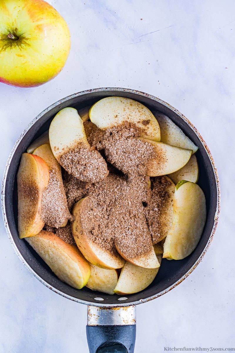 Apples and cinnamon in the pot.