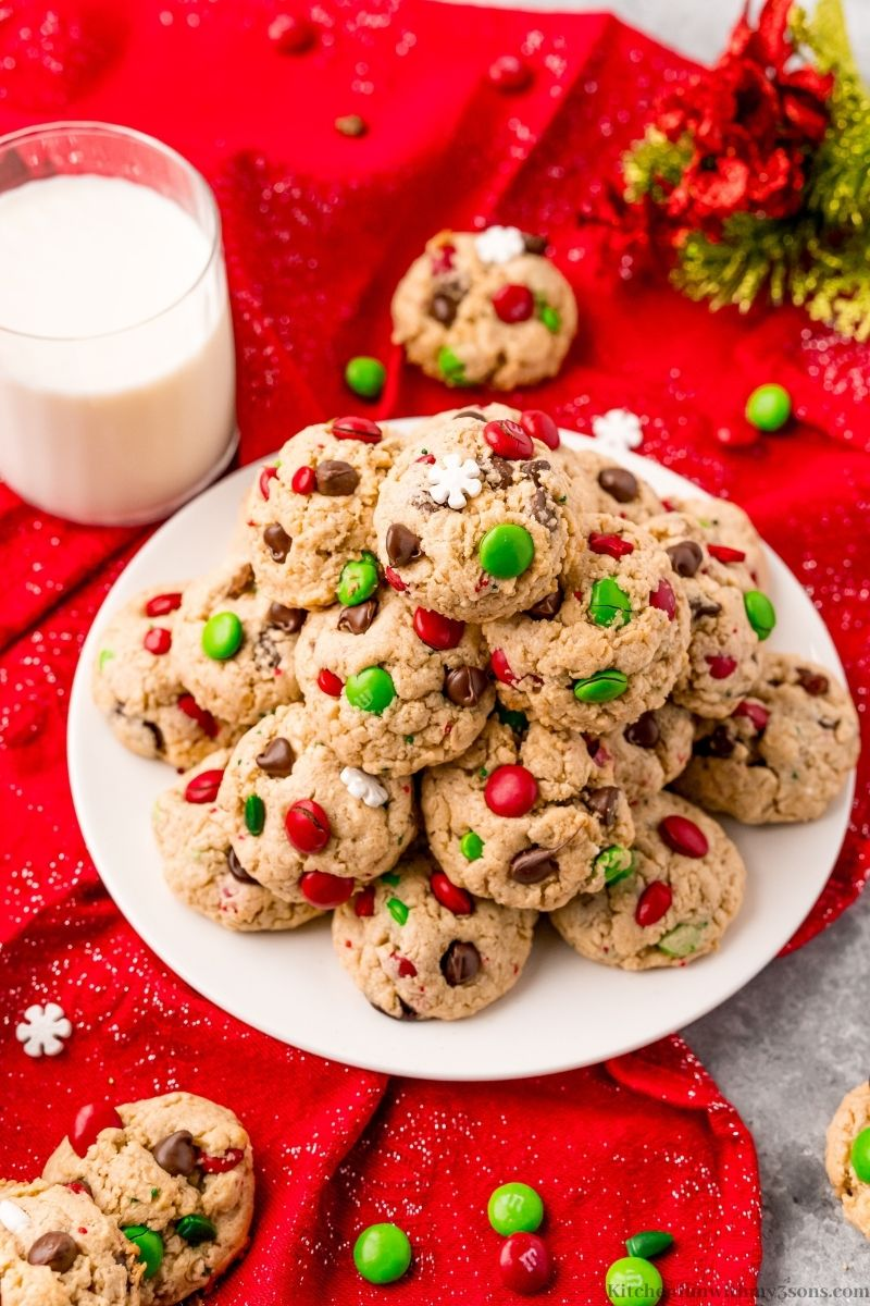 The Best Christmas Monster Cookies Recipe on a red table cloth.
