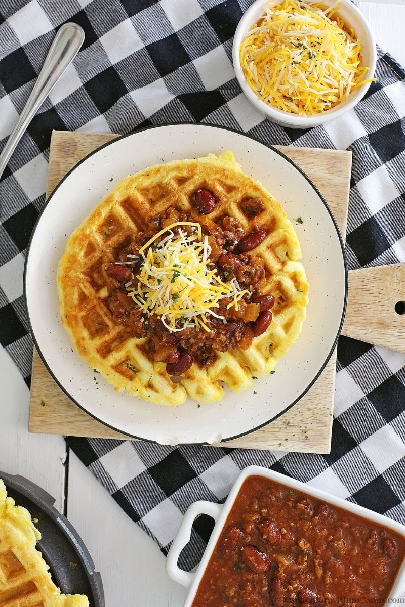 Cheesy Cornbread Waffles with Chili with more chili and cheese on the side.