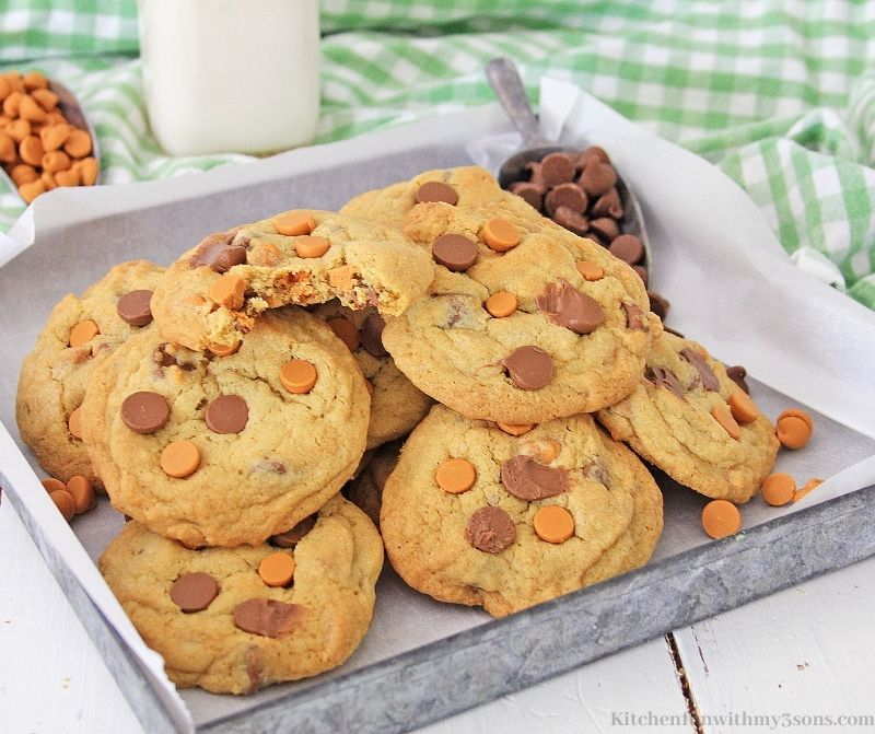 Chocolate Chip Butterscotch Cookies on a cookie sheet with parchment paper.