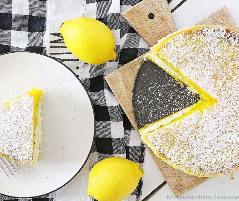 Lemon Bar Cheesecake on a pan with a slice taken out.