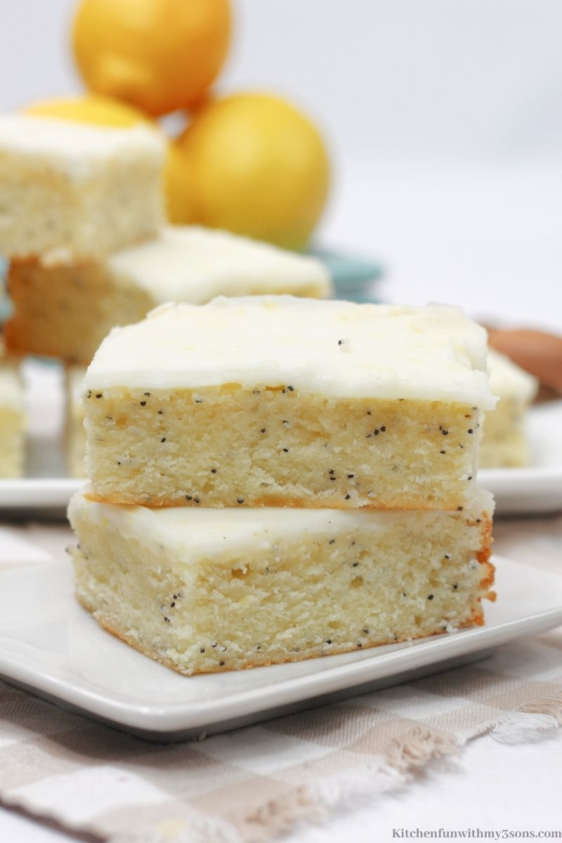 Lemon Poppy Seed Bars on a small square serving plate.