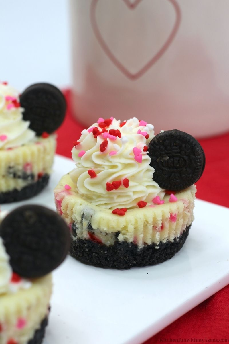 Valentine Cheesecake Bites on a red cloth.