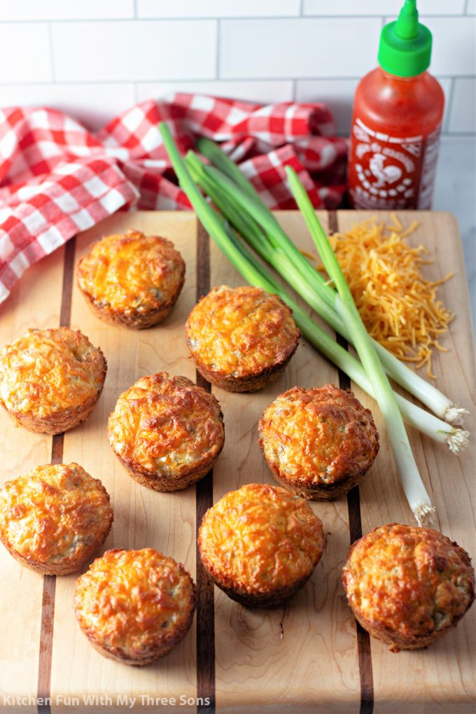 Sausage Breakfast Muffins on a wood cutting board