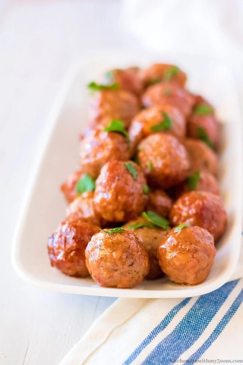 The meatballs on a white serving platter.