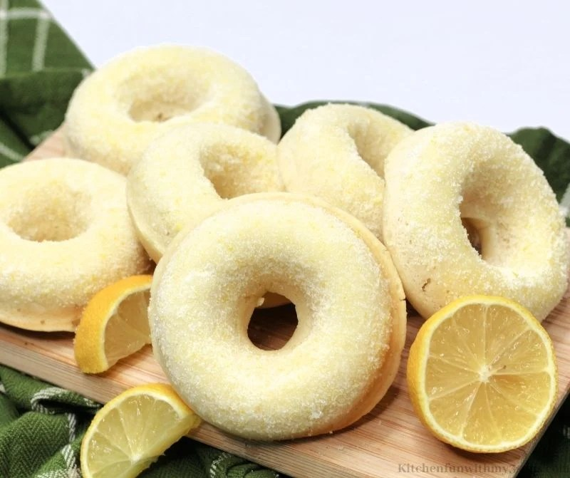 Sugared Lemon Donuts on a wooden board.