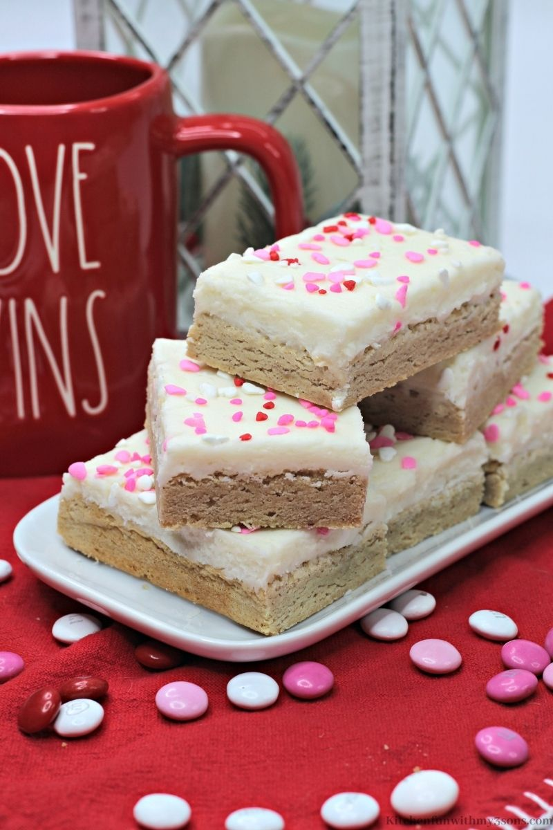 Valentine's Day Snickerdoodle Cookie Bar with sprinkled M&M's around them.