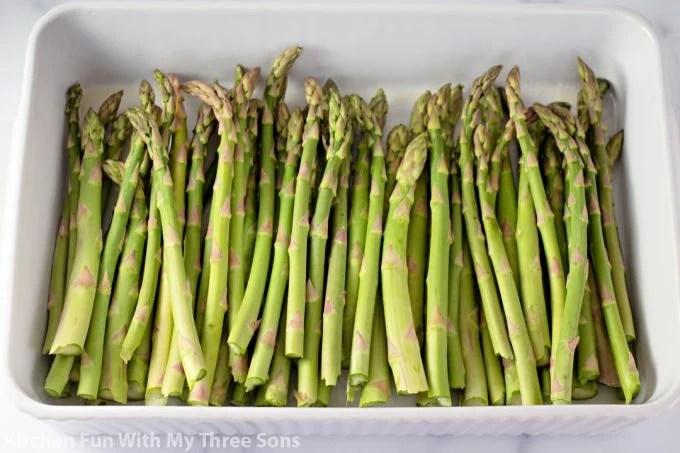 asparagus in a white baking dish.