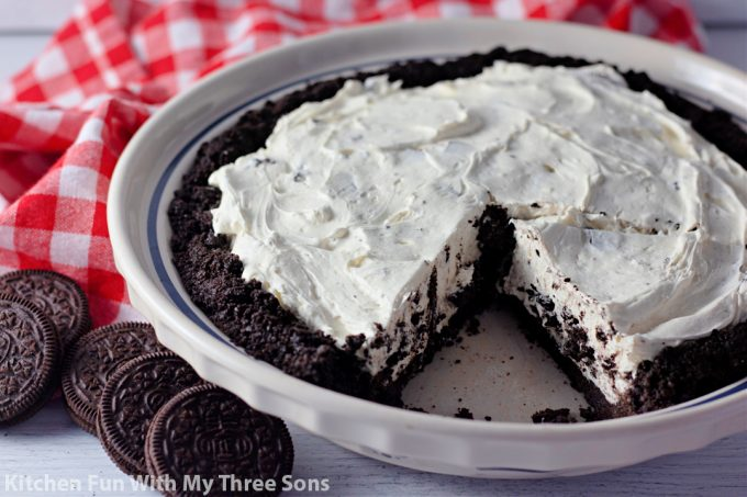 freshly made Oreo pie in a pie plate with a red napkin.
