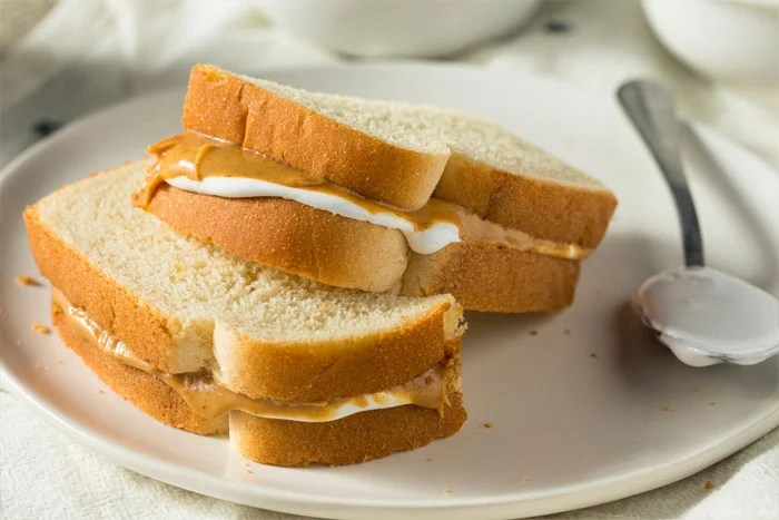 A Fluffernutter Sandwich brings back to many memories of childhood and I love sharing it with my own kids. Two layers of bread with a delicious layer of peanut butter and marshmallow fluff.