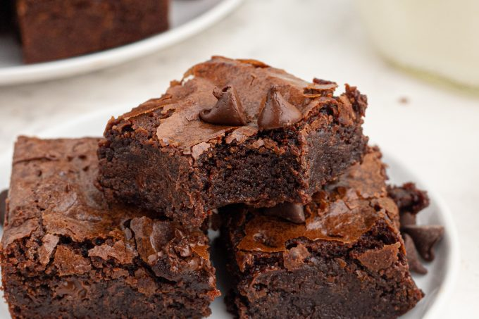 Bite taken from fudgy brownies