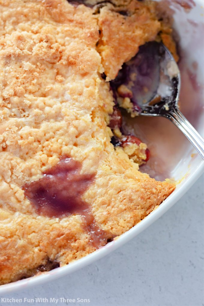 scooping Pineapple Cherry Dump Cake with a fork.