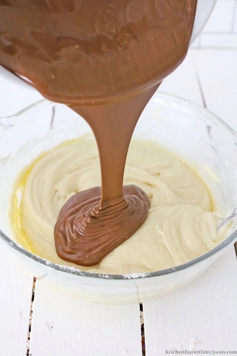 Adding the melted chocolate into the batter.