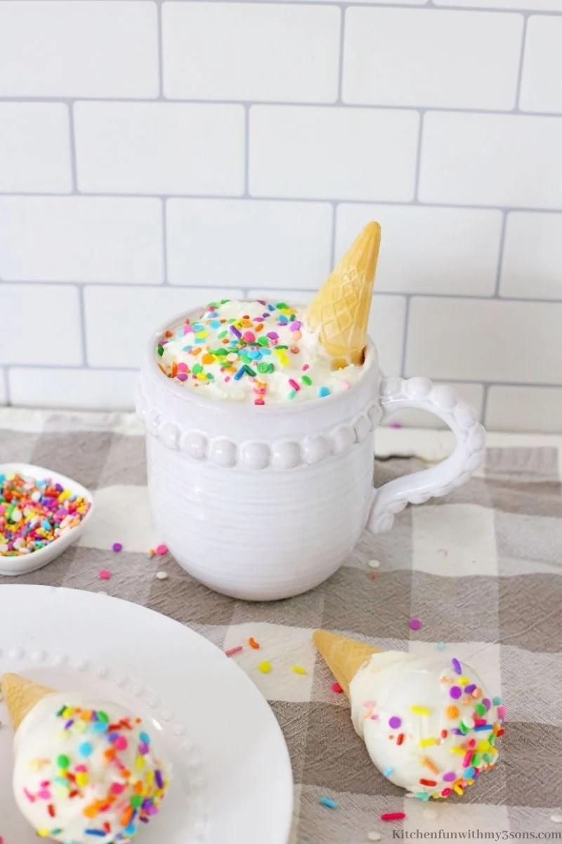 The cocoa bomb dipped into a mug.
