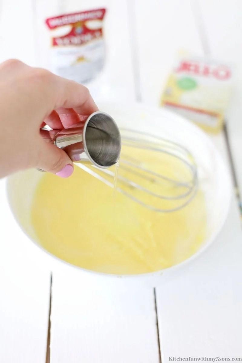 Adding a shot of Vodka into the Jello.