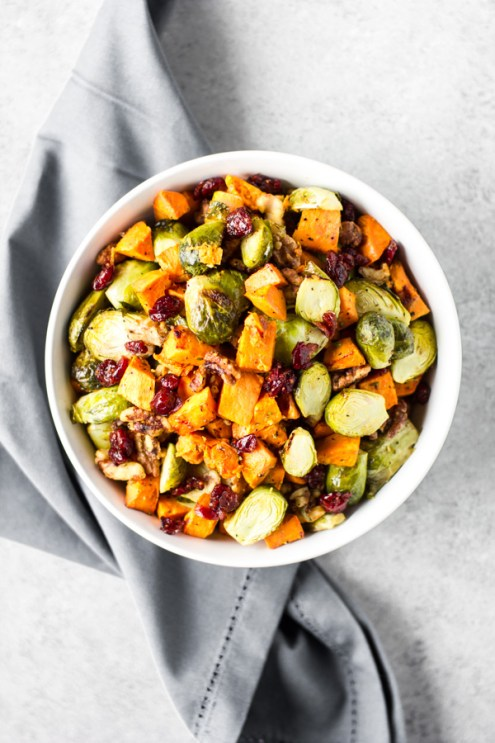 Oven Baked Brussel Sprouts w/ Sweet Potato is healthy side dish w/ a dash of sweet. Delicious roasted flavor & lightly seasoned to perfection. Paleo+Vegan