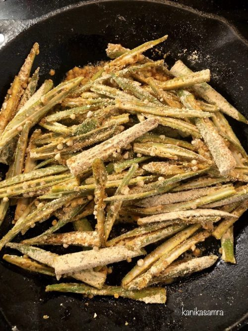 Cooking kurkuri bhindi. Easy bhindi recipe from Punjab.