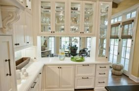 Glass-front-kitchen-cabinets-set-in-a-wooden-frame