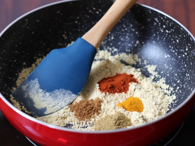 Masalas are added to the roasted gram flour