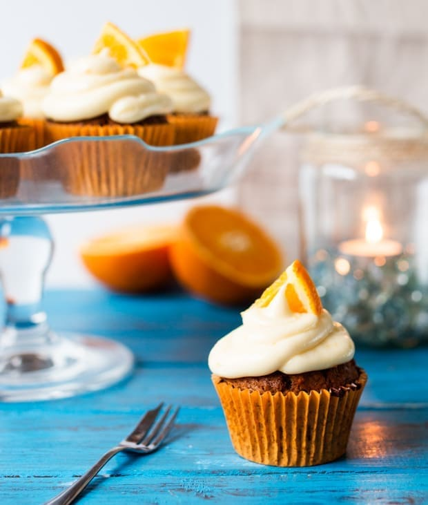 Moist and fluffy carrot & orange cupcakes with a hint of spice and lots of juicy raisins. All topped off with a zesty cream cheese frosting and orange wedges.