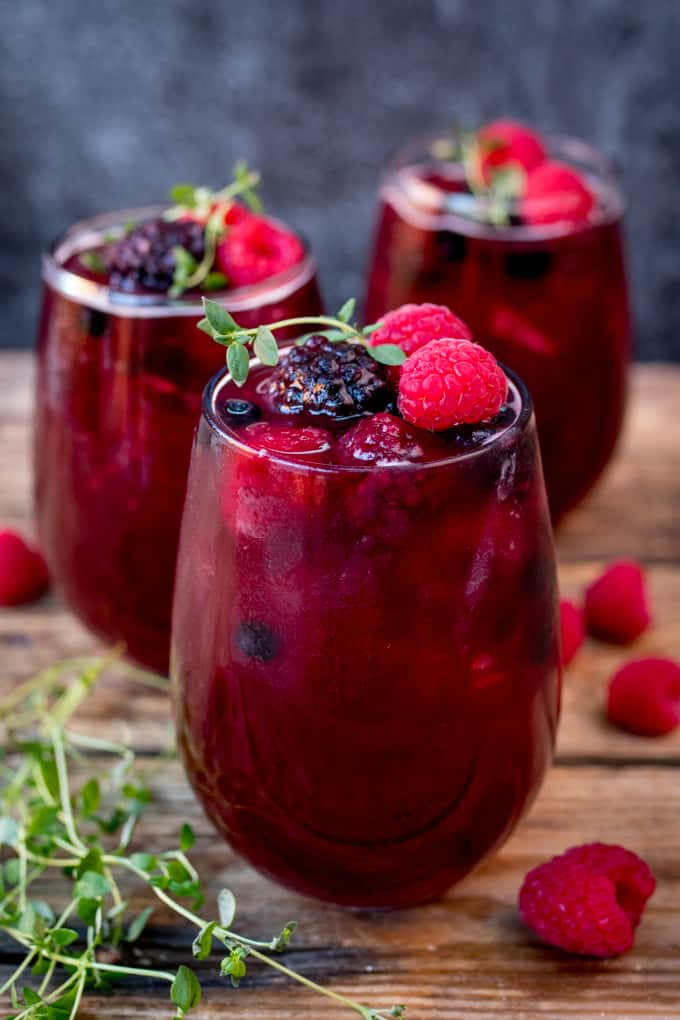 New Year's Eve Rum Berry Cocktail! With rum, Cointreau, pomegranate juice and ginger beer! Use frozen berries instead of ice cubes to finish the look!