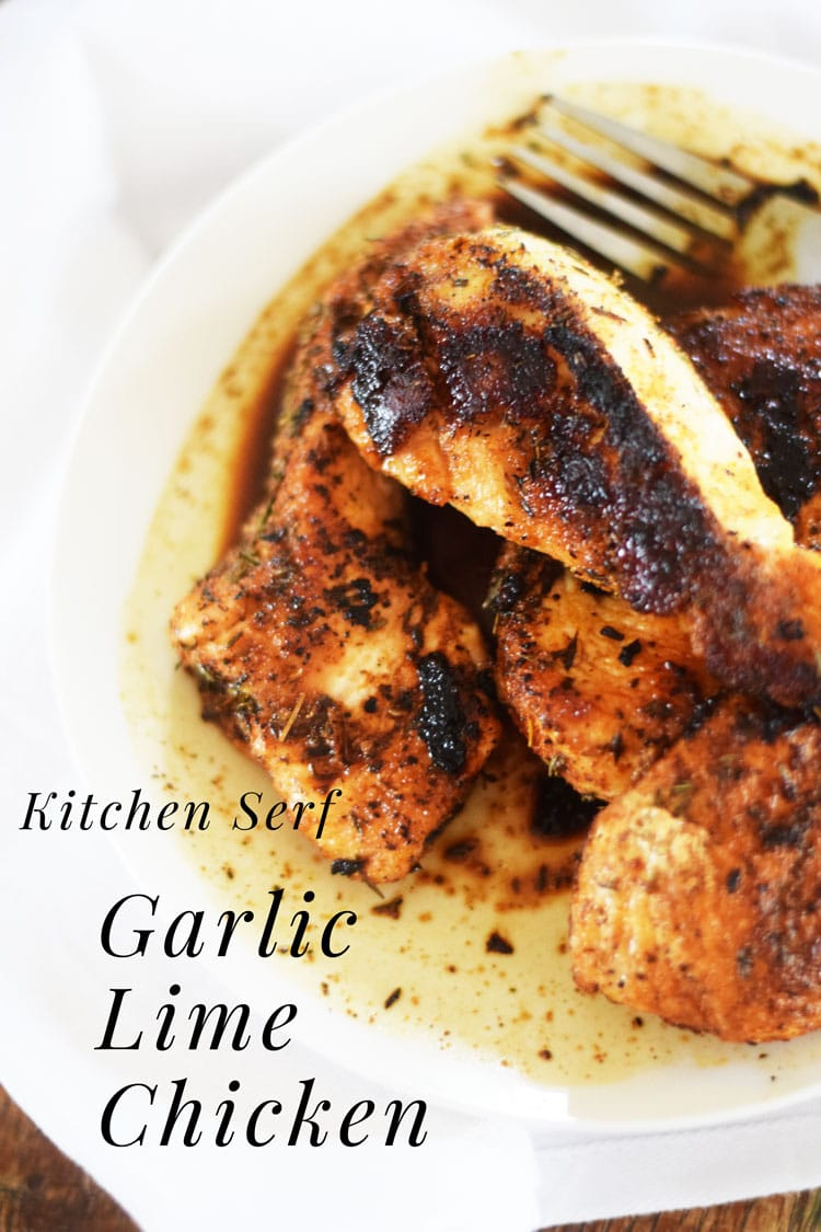 chicken breasts with spice rub on a white dish and a white table cloth