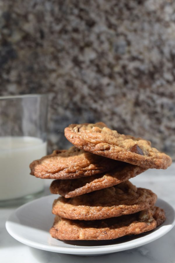 stack of five chocolate chip cookie and glass of milk