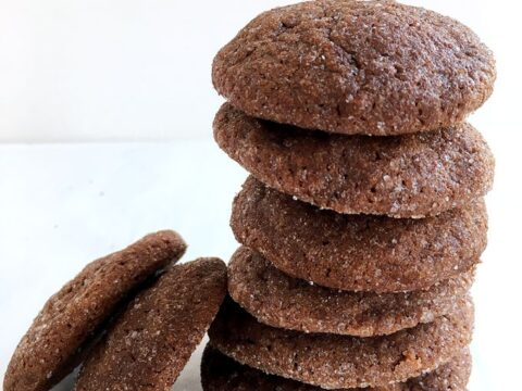 stack of chocolate cookies on a white plate