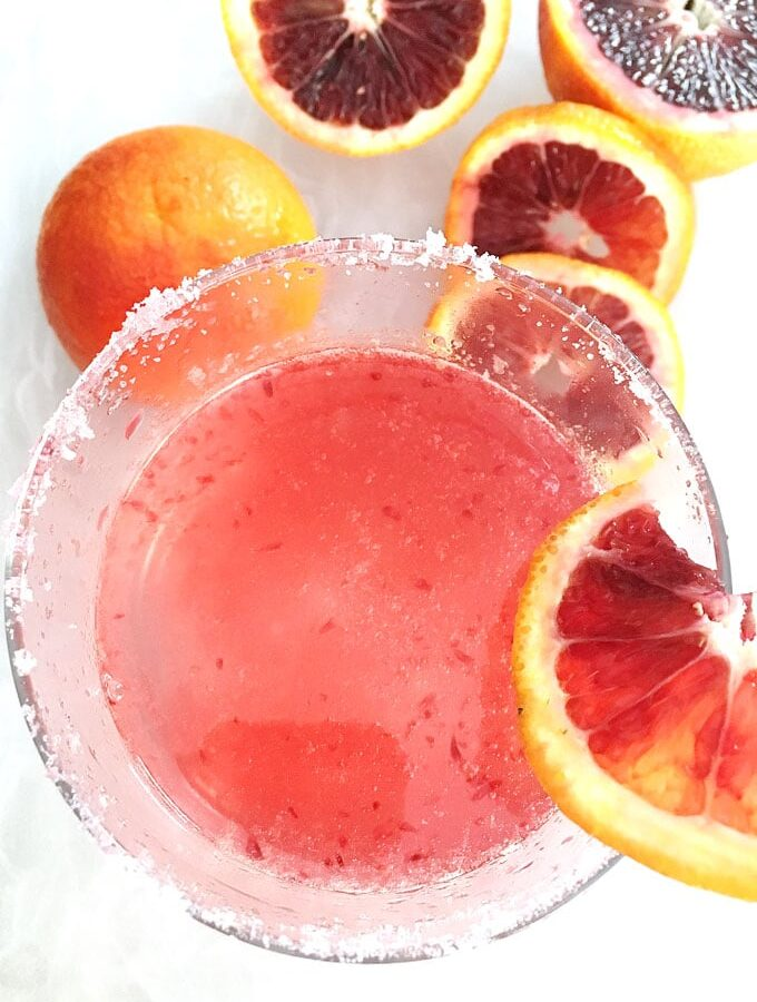 Blood orange juice, vodka and white soda or seltzer makes a great pink cocktail for girls' night or a refreshing drink after a game. #cocktails #vodka