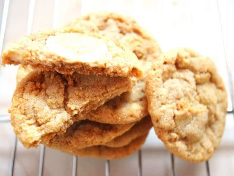 stack of cookies on wire cooling rack resting on counter