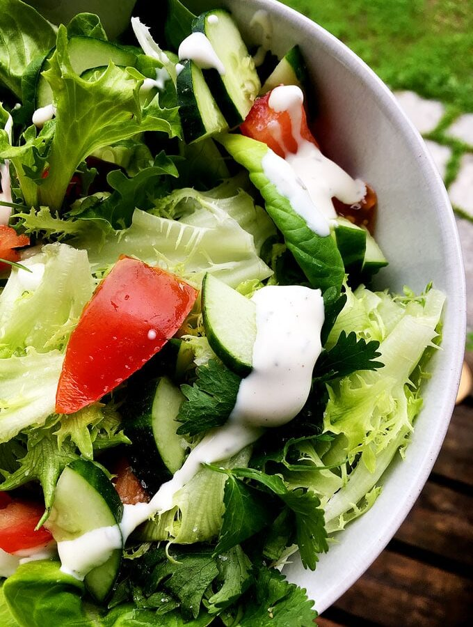 green salad in white bowl