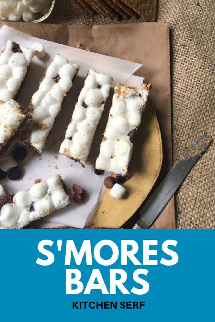 S'mores Bars feature a buttery, brown sugar graham cracker crust covered with a layer of chocolate ganache, which is topped with a layer of marshmallows, which melt together to create a rich, bite-size dessert.