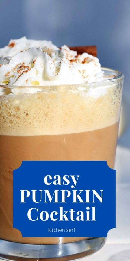 pumpkin cocktail in a glass topped with whipped cream and a sprinkle of ground cinnamon