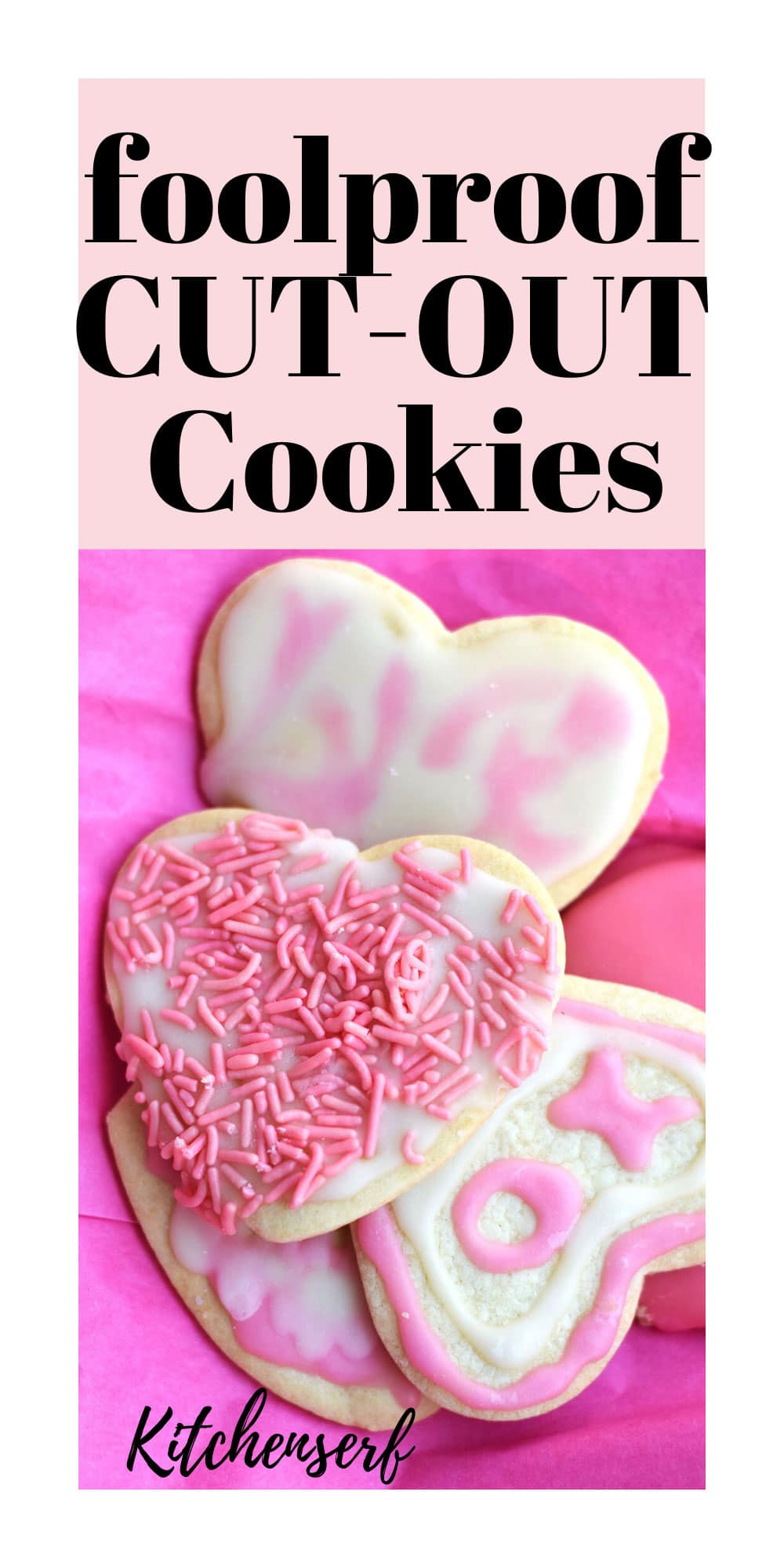 heart-shaped pink and white frosted sugar cookies laying on pink tissue paper