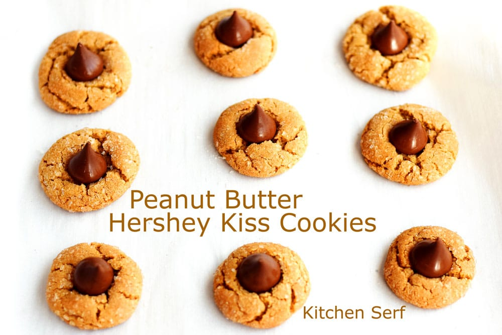 peanut butter cookies topped with chocolate shaped tear drop candies or kisses on a white background