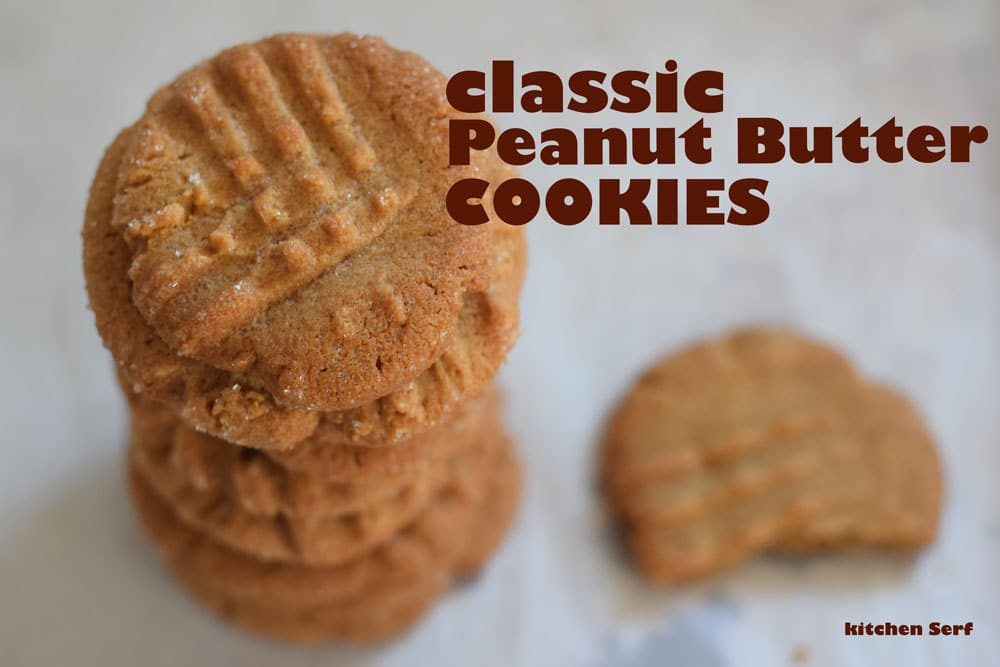 stack of peanut butter cookies on a piece of parchment paper