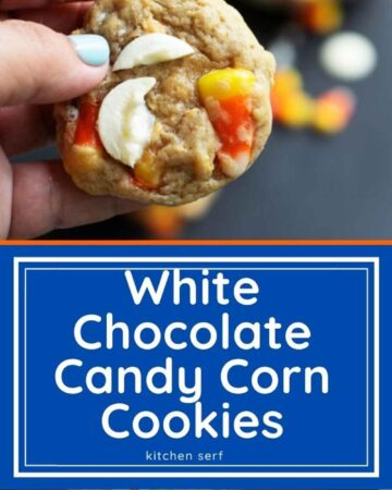 hand holding a cookie with candy corn and white chocolate