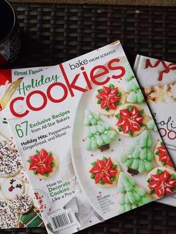christmas cookie magazines on a brown ottoman