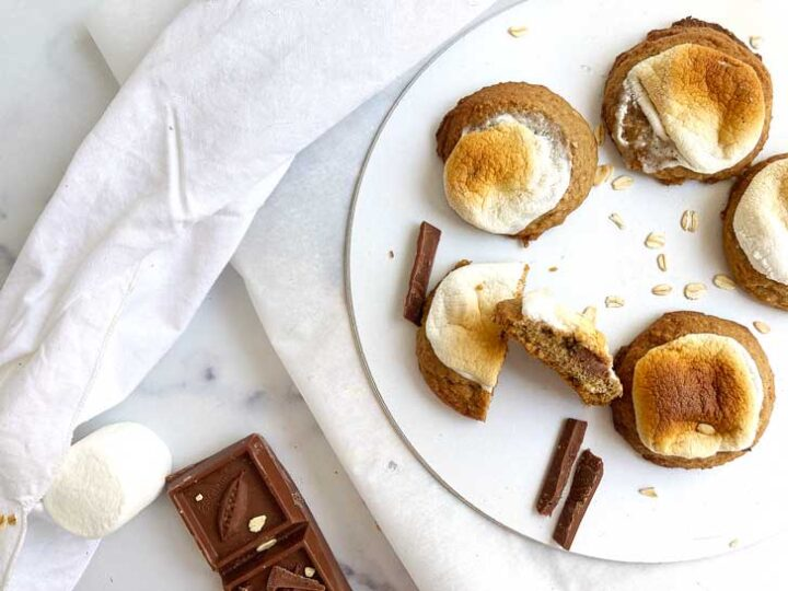 smores cookies on a white background with a bar of chocolate