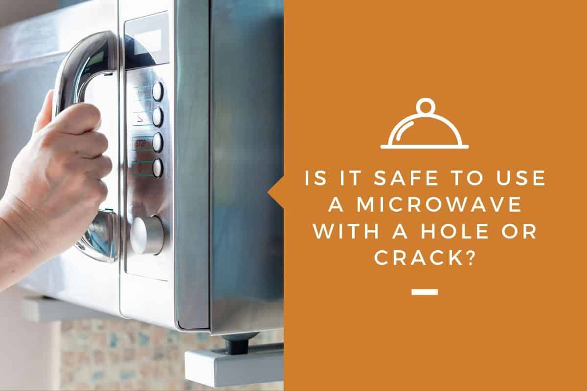 a microwave with a hole or crack