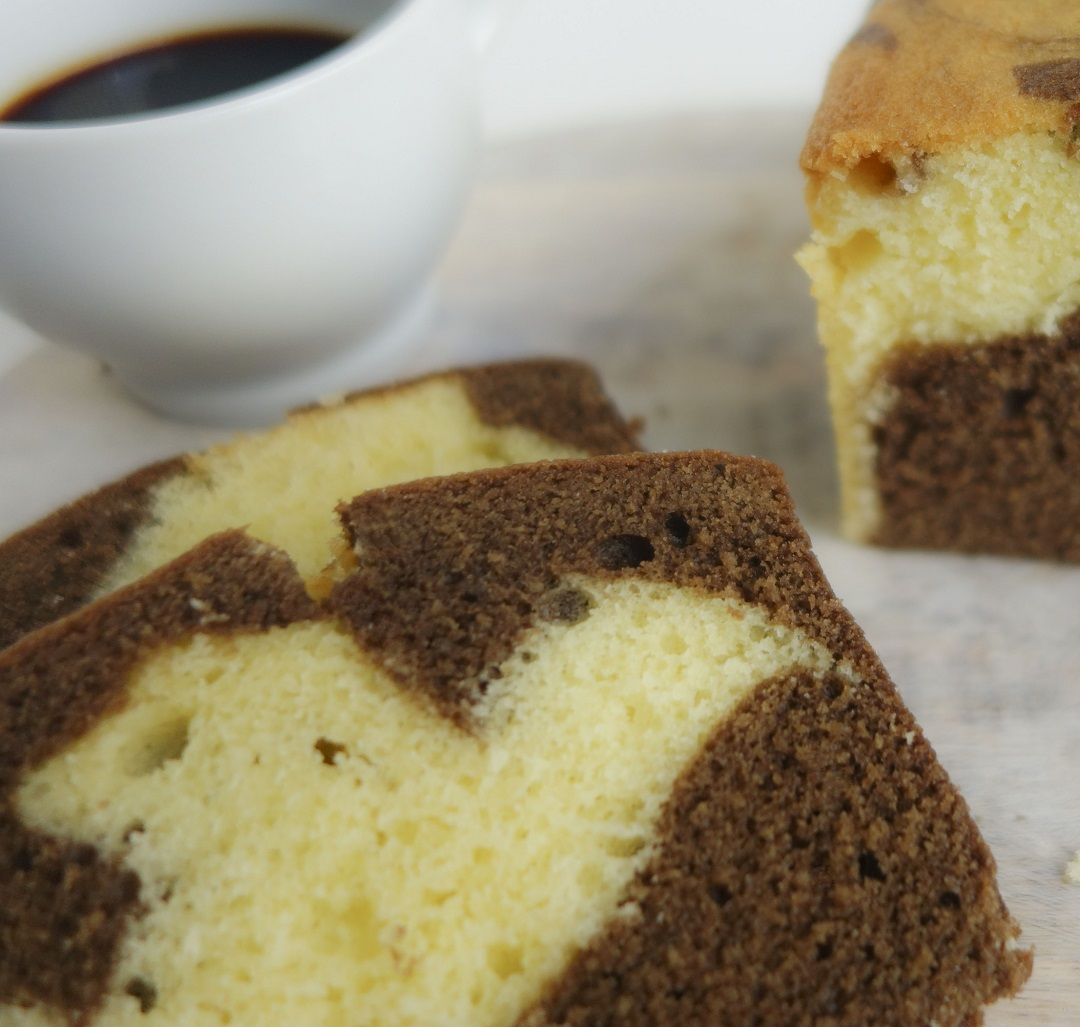 A super moist, buttery marble cake made with swirls of vanilla and chocolate. Perfect for a tea time treat or with a yummy frosting can become a birthday cake!
