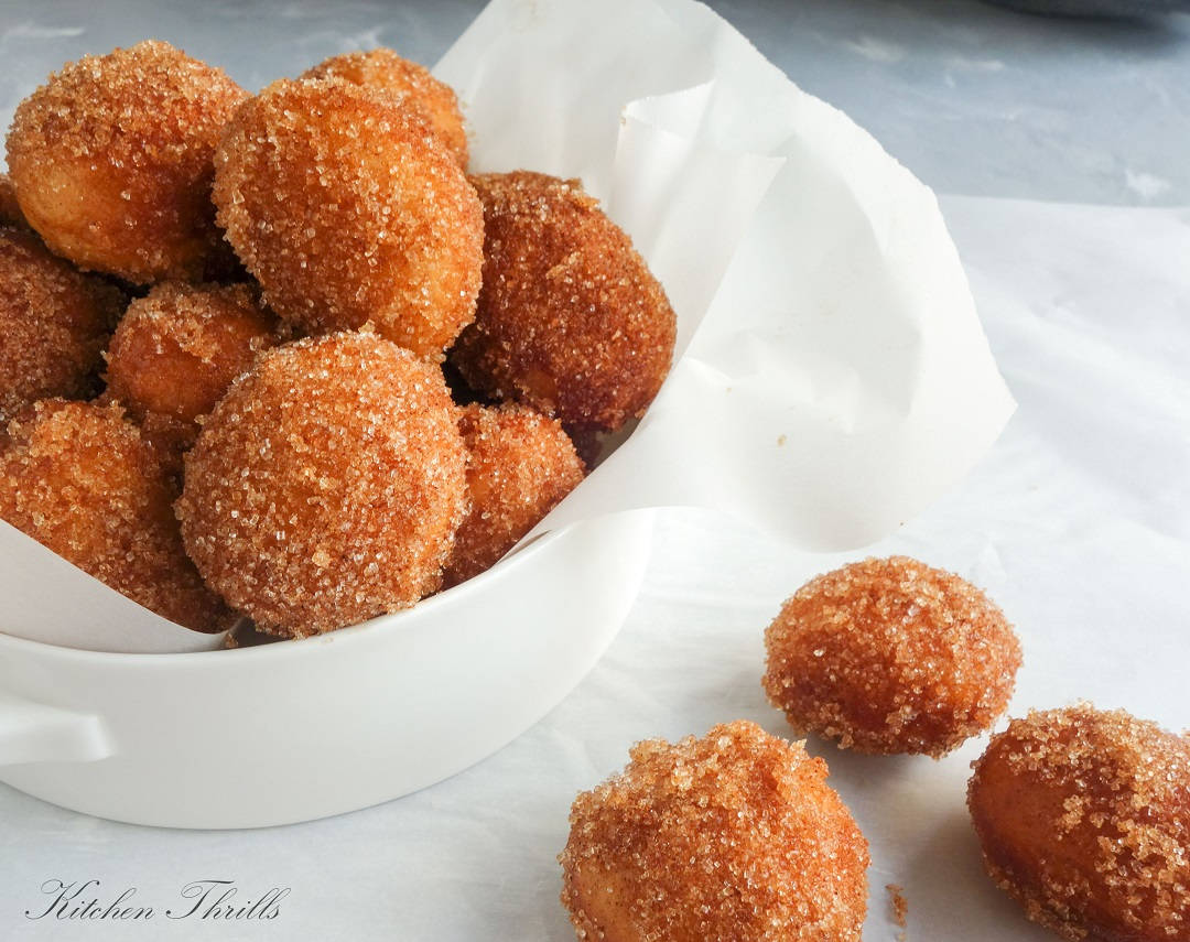 Warm, fluffy and light mini donuts made the traditional way with yeast and some kneading.
