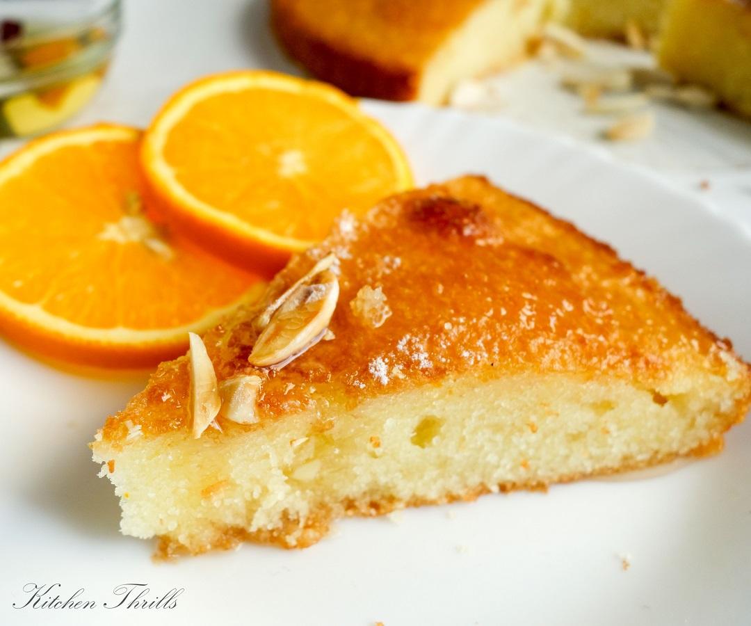 Moist Rava cake|Sooji cake flavoured with orange sugar syrup is the perfect tea time cake.