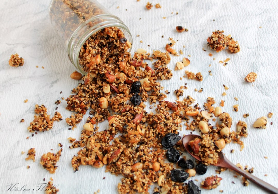 Sugar free sesame granola a simple homemade recipe with toasted sesame, shredded coconut and naturally sweetened with honey or maple syrup.