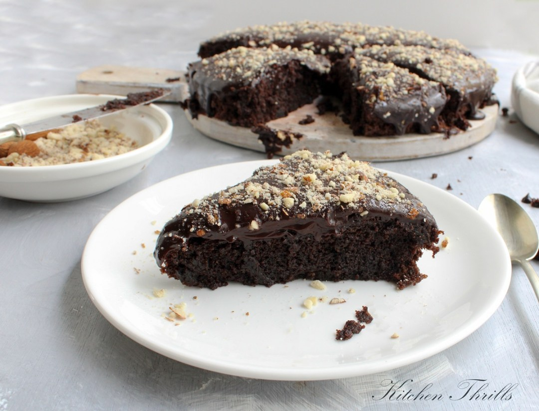 A quick and easy chocolate cake baked with whole wheat flour, dark chocolate and pureed beets and frosted with chocolate ganache. #chocolatecake #healthycake