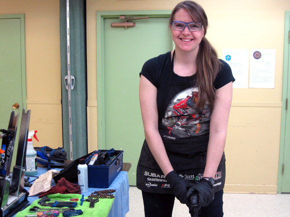 "Lauren Goodhew of Westboro, in her sixteenth year as a professional bike mechanic, says fixing bikes is her job, but also her passion. She and other volunteer mechanics spruced up around 25 bikes during the ""On Your Bike"" event. Photo by Denise Deby."